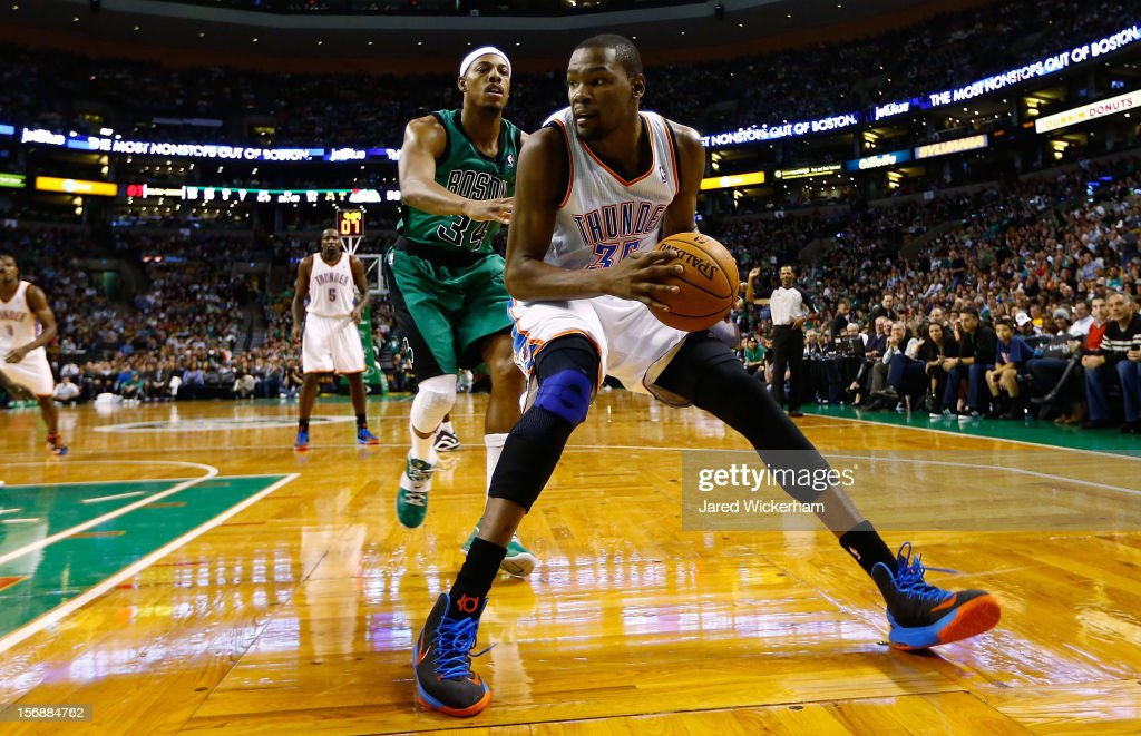 Kevin Durant #35 of the Oklahoma City Thunder handles the ball along the baseline in front of Paul Pierce #34 of the Boston Celtics during the game on November 23, 2012 at TD Garden in Boston, Massachusetts.