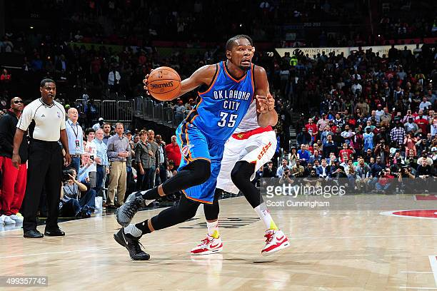 Kevin Durant of the Oklahoma City Thunder handles the ball during the game against the Atlanta Hawks on November 30 2015 at Philips Arena in Atlanta...