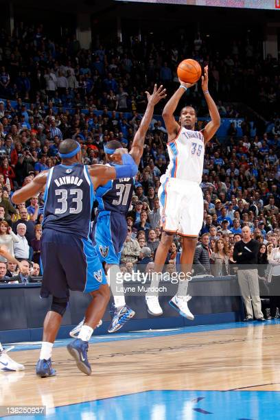 Kevin Durant of the Oklahoma City Thunder hits the game winning 3pointer as time expires to defeat the Dallas Mavericks 104102 during an NBA game on...