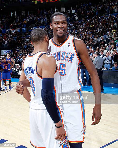 Kevin Durant of the Oklahoma City Thunder hugs his teammate Russell Westbrook of the Oklahoma City Thunder after his game winning 3pointer against...
