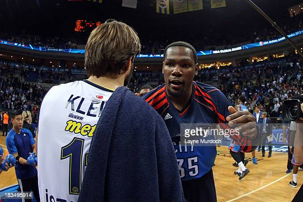 Kevin Durant of the Oklahoma City Thunder hugs Linas Kleiza of the Fenerbahce Ulker after their game concluded as part of the NBA Global Games on...