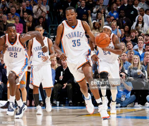 Kevin Durant of the Oklahoma City Thunder leads his teammates Jeff Green Earl Watson and Chris Wilcox up the court during a game against the Phoenix...