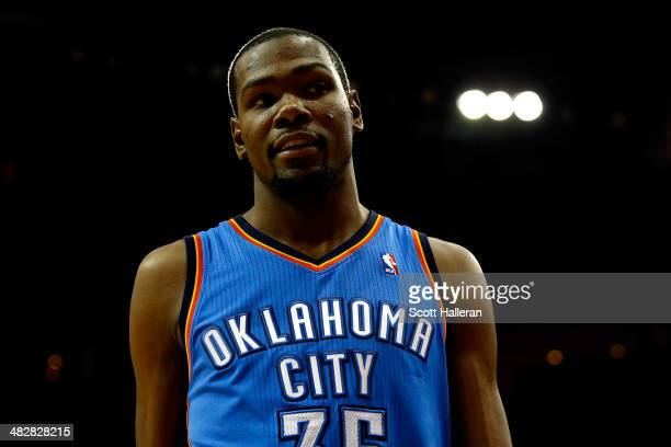 Kevin Durant of the Oklahoma City Thunder looks on against the Houston Rockets during a game at the Toyota Center on April 4 2014 in Houston Texas...
