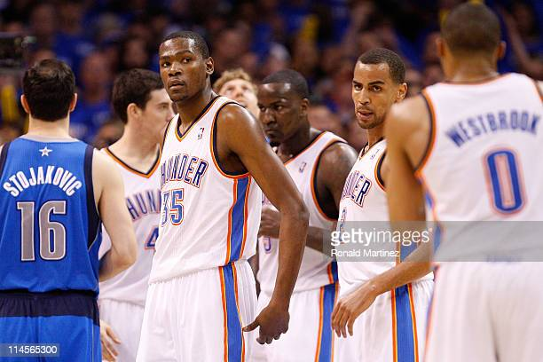 Kevin Durant of the Oklahoma City Thunder looks on in the third quarter while taking on the Dallas Mavericks in Game Four of the Western Conference...