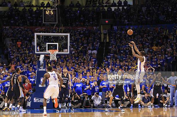Kevin Durant of the Oklahoma City Thunder makes a threepoint shot with 126 seconds left against the Memphis Grizzlies during Game One of the Western...