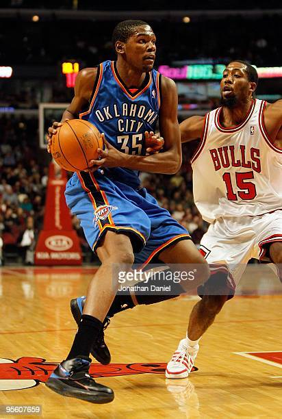 Kevin Durant of the Oklahoma City Thunder moves the ball against John Salmons of the Chicago Bulls at the United Center on January 4 2010 in Chicago...