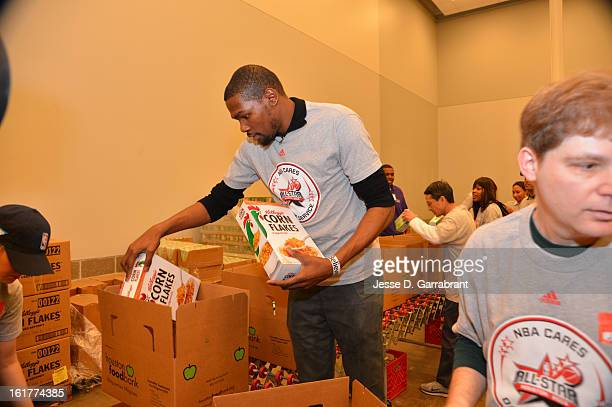 Kevin Durant of the Oklahoma City Thunder participates at the 2013 NBA Cares Day of Service at the Food Bank on February 15 2013 in Houston Texas...