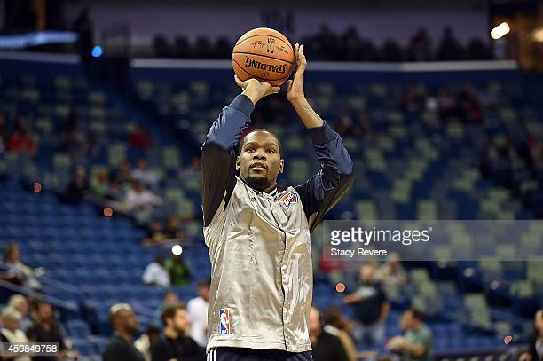 Kevin Durant of the Oklahoma City Thunder participates in warmups prior to a game against the New Orleans Pelicans at the Smoothie King Center on...