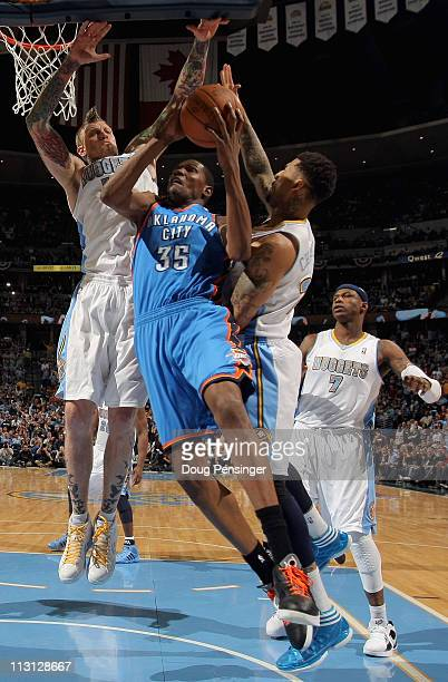 Kevin Durant of the Oklahoma City Thunder puts up a shot against Chris Andersen and Wilson Chandler of the Denver Nuggets in Game Three of the...
