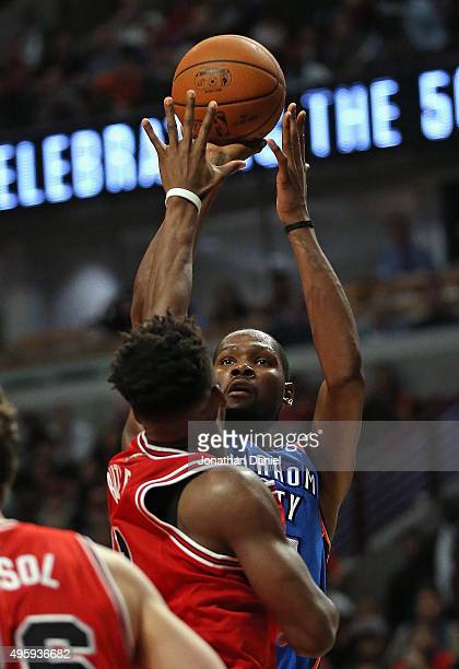 Kevin Durant of the Oklahoma City Thunder puts up a shot over Jimmy Butler of the Chicago Bulls on his way to a gamehigh 33 points at the United...