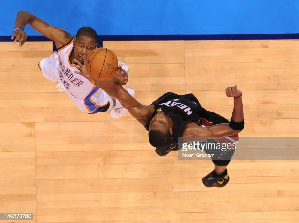 Kevin Durant of the Oklahoma City Thunder reached for the ball against Chris Bosh of the Miami Heat during Game Two of the 2012 NBA Finals at...