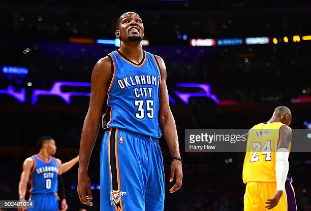 Kevin Durant of the Oklahoma City Thunder reacts after a play in front of Kobe Bryant of the Los Angeles Lakers and Russell Westbrook during a 12085...