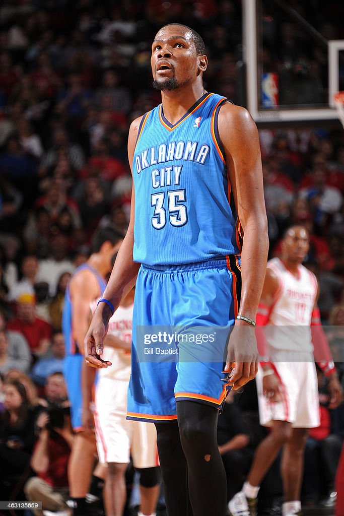 Kevin Durant #35 of the Oklahoma City Thunder reacts to a play against the Houston Rockets on January 16, 2014 at the Toyota Center in Houston, Texas.