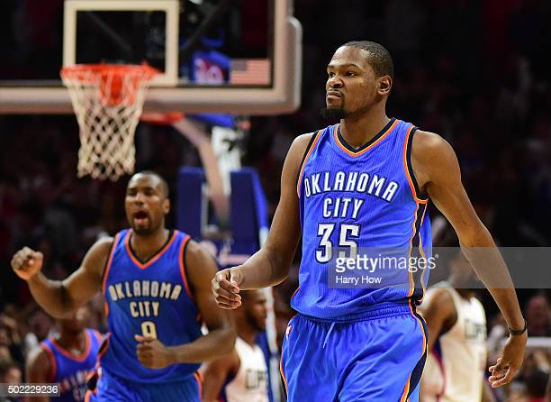 Kevin Durant of the Oklahoma City Thunder reacts to his basket along with Serge Ibaka in the final seconds of a 10099 Thunder win over the Los...