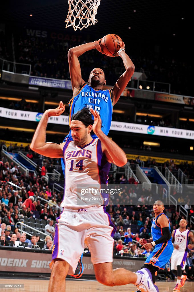 Kevin Durant #35 of the Oklahoma City Thunder rises for a dunk against Luis Scola #14 of the Phoenix Suns on January 14, 2013 at U.S. Airways Center in Phoenix, Arizona.