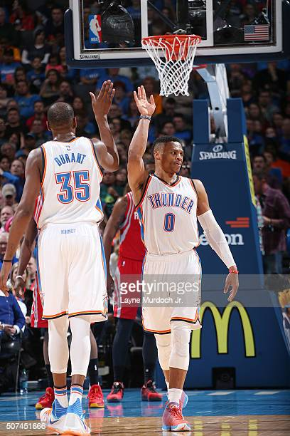 Kevin Durant of the Oklahoma City Thunder shakes hands with Russell Westbrook of the Oklahoma City Thunder during the game against the Houston...