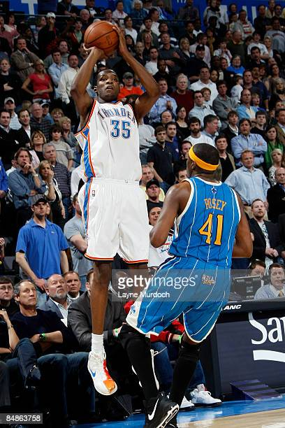 Kevin Durant of the Oklahoma City Thunder shoots a 3pointer over James Posey of the New Orleans Hornets to tie the game with 138 seconds on February...