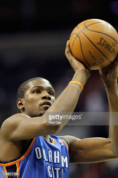 Kevin Durant of the Oklahoma City Thunder shoots a free throw against the Washington Wizards during the first half at the Verizon Center on March 14...