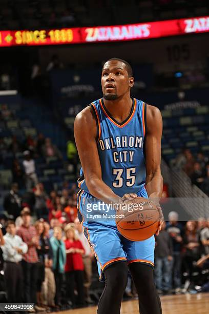 Kevin Durant of the Oklahoma City Thunder shoots a free throw against the New Orleans Pelicans during the game on December 2 2014 at the Smoothie...