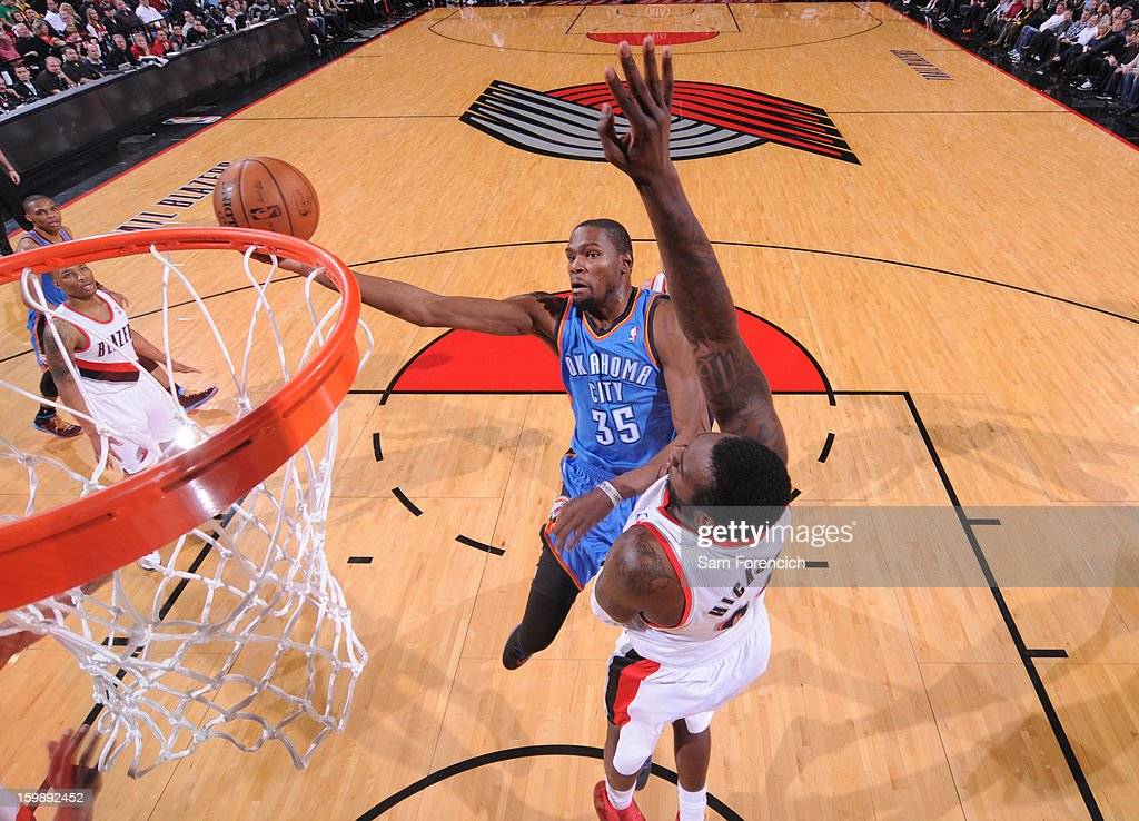 Kevin Durant #35 of the Oklahoma City Thunder shoots a layup against J.J. Hickson #21 of the Portland Trail Blazers on January 13, 2013 at the Rose Garden Arena in Portland, Oregon.