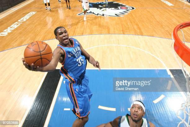 Kevin Durant of the Oklahoma City Thunder shoots a layup against Ryan Gomes of the Minnesota Timberwolves during the game at Target Center on...