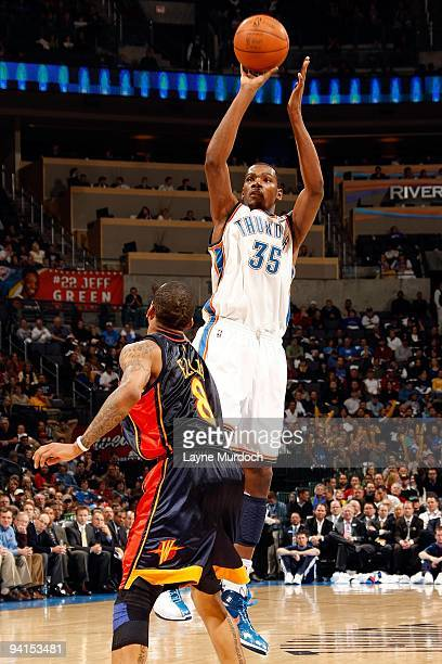 Kevin Durant of the Oklahoma City Thunder shoots against Monta Ellis of the Golden State Warriors during the game on December 7 2009 at the Ford...