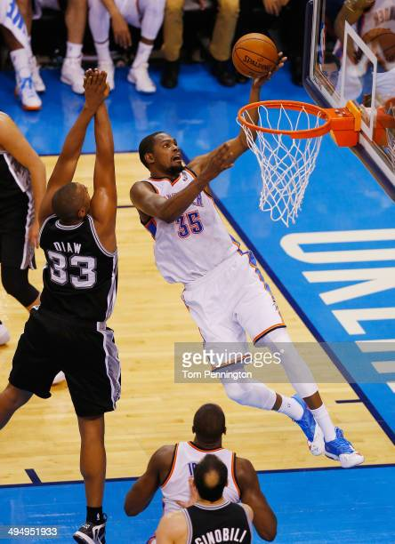 Kevin Durant of the Oklahoma City Thunder shoots over Boris Diaw of the San Antonio Spurs in the second half during Game Six of the Western...