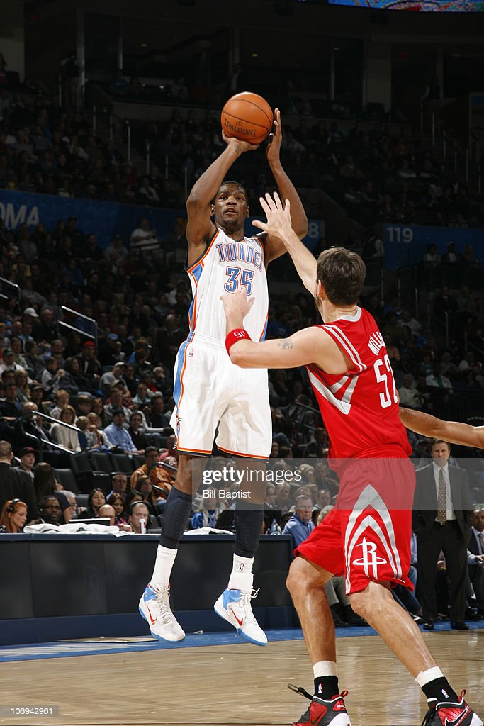 Kevin Durant #35 of the Oklahoma City Thunder shoots over Brad Miller #52 of the Houston Rockets on November 17, 2010 at the Oklahoma City Arena in Oklahoma City, Oklahoma.