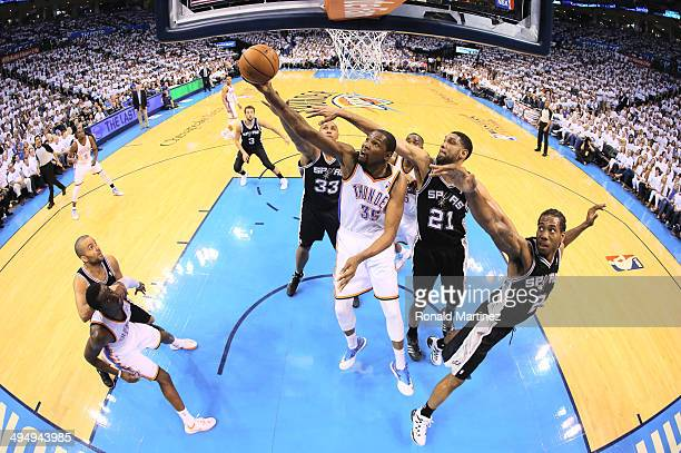 Kevin Durant of the Oklahoma City Thunder shoots the ball the ball as Tim Duncan and Kawhi Leonard of the San Antonio Spurs defend in the first half...