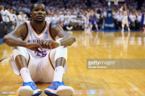 Kevin Durant of the Oklahoma City Thunder sits on the court as Russell Westbrook makes three free throws against the Los Angeles Clippers to take the...