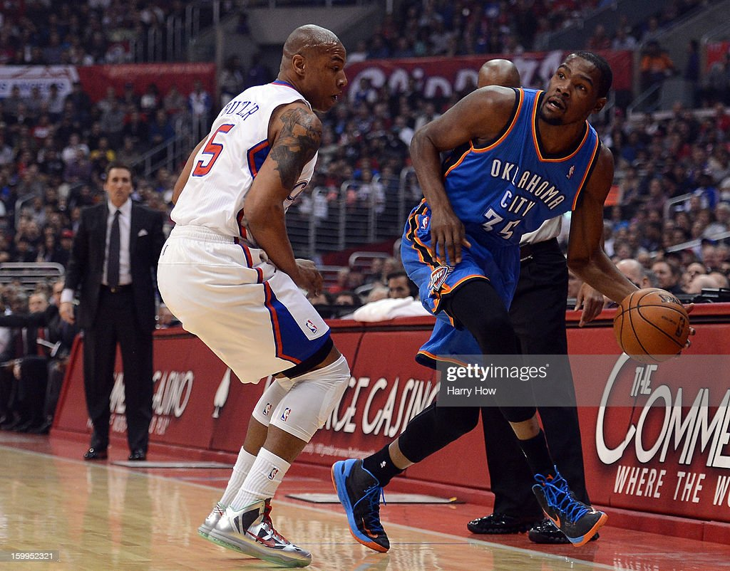 Kevin Durant #35 of the Oklahoma City Thunder steps out of bounds in front of Caron Butler #5 of the Los Angeles Clippers during a 109-97 Thunder win at Staples Center on January 22, 2013 in Los Angeles, California.