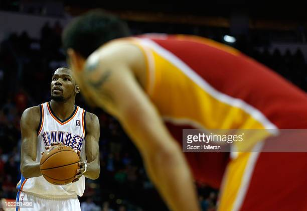 Kevin Durant of the Oklahoma City Thunder takes a free throw during the game against the Houston Rockets at Toyota Center on February 20 2013 in...