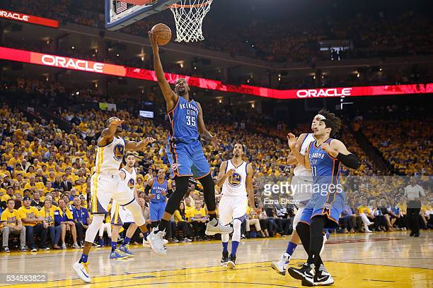 Kevin Durant of the Oklahoma City Thunder takes a shot against the Golden State Warriors during Game Five of the Western Conference Finals during the...
