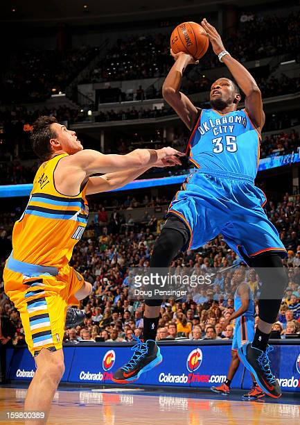 Kevin Durant of the Oklahoma City Thunder takes a shot and is fouled by Danilo Gallinari of the Denver Nuggets at the Pepsi Center on January 20,...