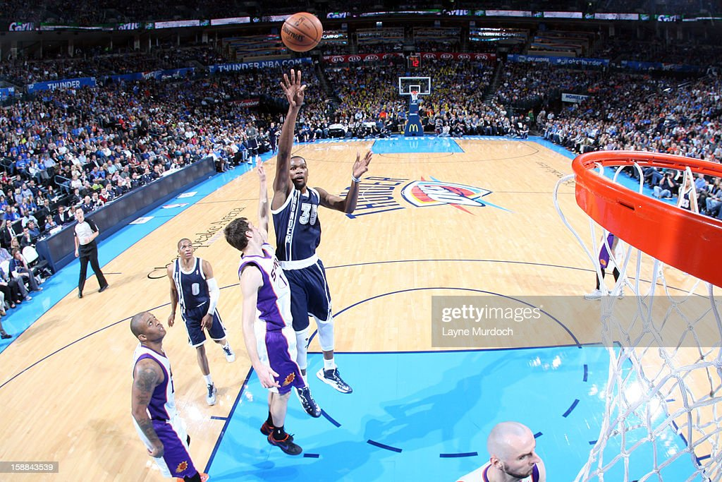 Kevin Durant #35 of the Oklahoma City Thunder takes a shot in the paint against the Phoenix Suns during an NBA game on December 31, 2012 at the Chesapeake Energy Arena in Oklahoma City, Oklahoma.