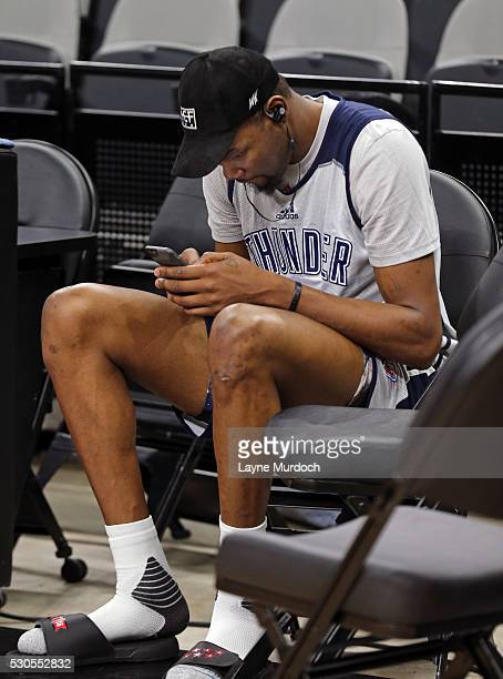 Kevin Durant of the Oklahoma City Thunder texts on his phone during a practice before Game Five of the NBA Western Conference Semifinals against the...
