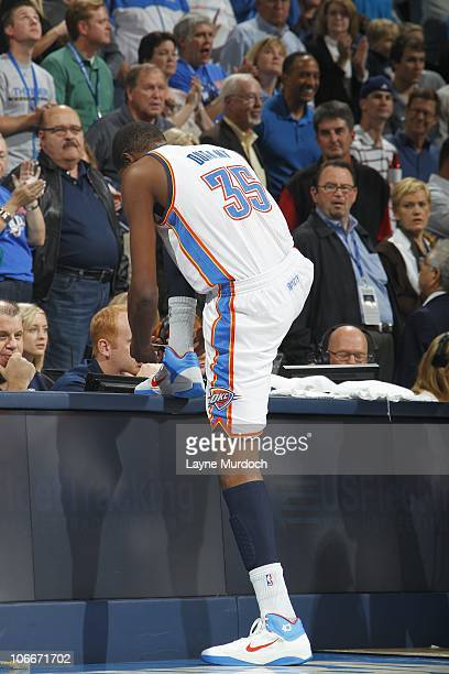 Kevin Durant of the Oklahoma City Thunder ties his shoe at the sideline during a game against the Boston Celtics on November 7 2010 at the Ford...