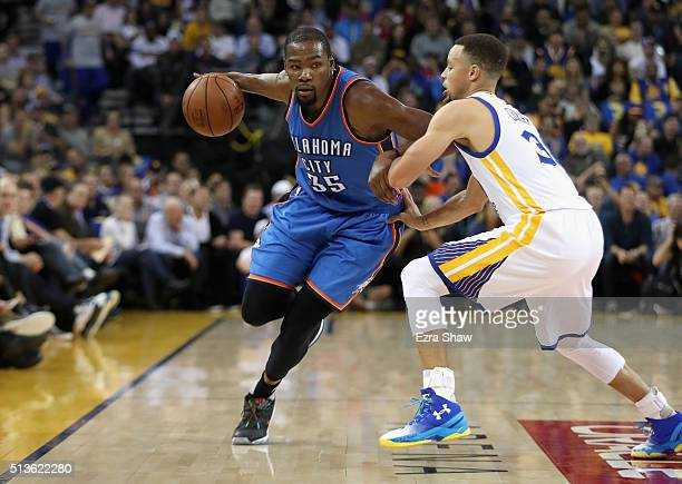 Kevin Durant of the Oklahoma City Thunder tries to dribble past Stephen Curry of the Golden State Warriors at ORACLE Arena on March 3 2016 in Oakland...