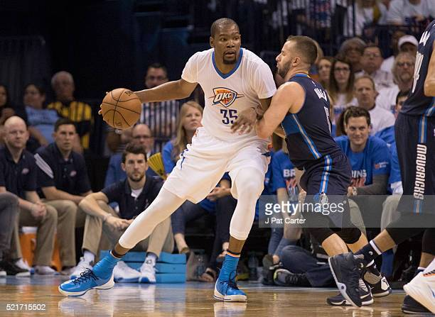 Kevin Durant of the Oklahoma City Thunder tries to drive around JJ Barea of the Dallas Mavericks during the first half of Game One of the Western...