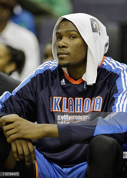 Kevin Durant of the Oklahoma City Thunder watches from the bench against the Washington Wizards during the first half at the Verizon Center on March...
