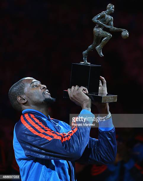 Kevin Durant of the Oklahoma City Thunder with the Maurice Podoloff Trophy after being named the 2013-14 KIA Player of the Year before Game Two of...