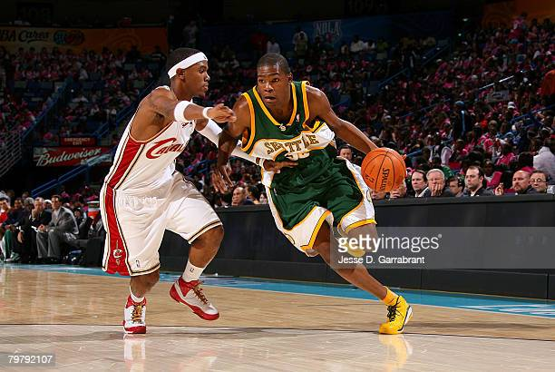 Kevin Durant of the Rookie team drives against Daniel Gibson of the Sophomore team during the TMobile Rookie Challenge Youth Jam part of 2008 NBA...