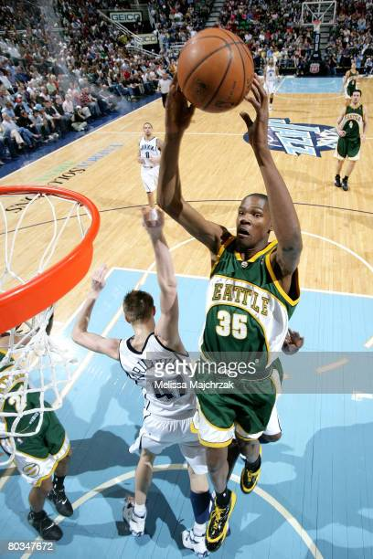 Kevin Durant of the Seattle Sonics has the ball knocked loose by Andrei Kirilenko of the Utah Jazz at EnergySolutions Arena on March 22 2008 in Salt...