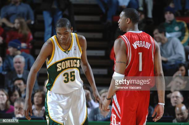 Kevin Durant of the Seattle SuperSonics defends against Tracy McGrady of the Houston Rockets during the game on January 23 2008 at the Key Arena in...