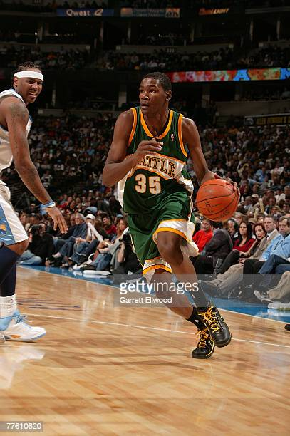 Kevin Durant of the Seattle Supersonics drives to the basket against Carmelo Anthony of the Denver Nuggets on October 31 2007 at the Pepsi Center in...