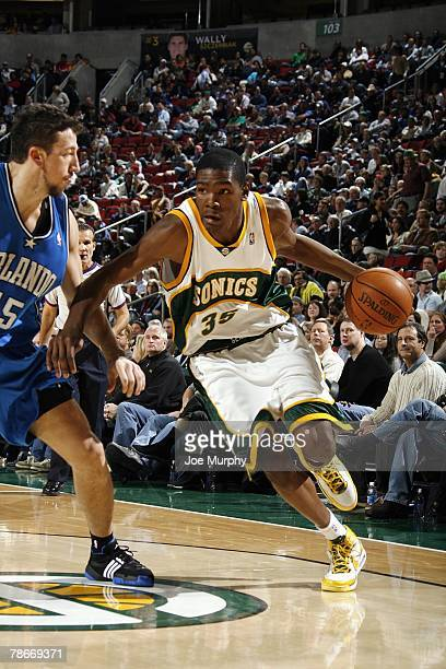 Kevin Durant of the Seattle SuperSonics drives to the basket against Hedo Turkoglu of the Orlando Magic during the game at Key Arena on November 28...