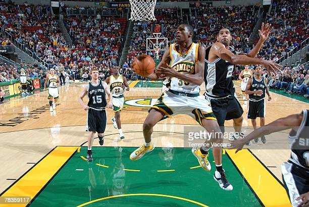 Kevin Durant of the Seattle SuperSonics goes strong to the hoop against Tim Duncan of the San Antonio Spurs on November 25 2007 at the Key Arena in...