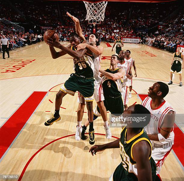 Kevin Durant of the Seattle SuperSonics goes to the basket against Luis Scola of the Houston Rockets during the game on January 21 2008 at the Toyota...