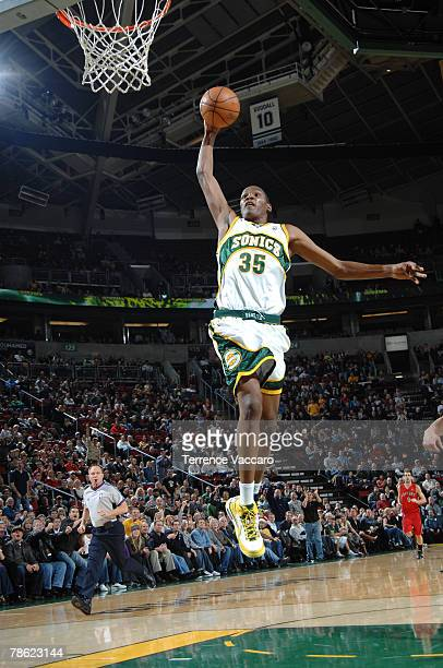 Kevin Durant of the Seattle SuperSonics goes to the basket past the defense of the Toronto Raptors on December 21 2007 at the Key Arena in Seattle...
