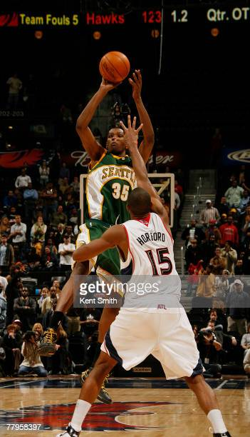 Kevin Durant of the Seattle SuperSonics hits the gamewinning three point shot against Al Horford of the Atlanta Hawks on November 16 2007 at the...